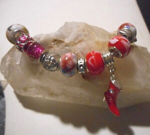 Home assembled European style charm bracelet with glass beads & silver charms