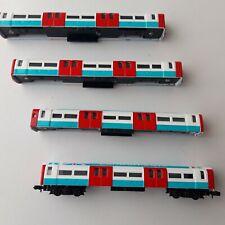 N Gauge rake of 4 converted `Corgi' London Transport Underground Tube coaches GC
