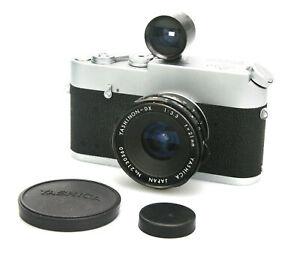 Yashica Yashinon DX 21mm f/3.3 Wide Angle Lens, Yashica Finder, Case & Caps - M4