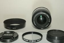 Nikon AI 24mm f2.8 Manual focus lens in perfect condition w/ Covers/ Hood/ UV