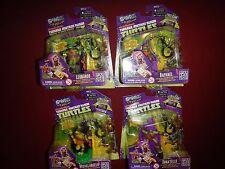 Lot of 4 Teenage Mutant Ninja Turtles : Swapp Toy Keychain Game Piece - New