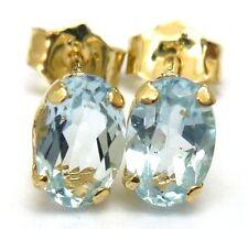 10KT YELLOW GOLD OVAL 4 X 6 MM BLUE TOPAZ STUD EARRINGS   E960