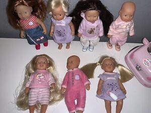 7 Zapf Creations Mini Baby Born Dolls And Car
