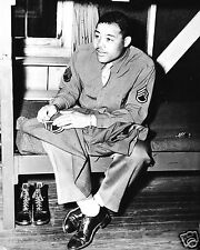 1945-Joe Louis-The Brown Bomber-Sews on Stripes for his Tech Sergeant Promotion