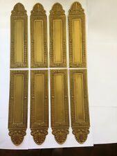 Huit anciennes plaques de propreté en laiton de style Empire à palmettes