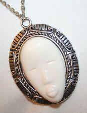 Striking Swirl Etch Rimmed Cream Ceramic Native Mask Silvertone Pendant Necklace