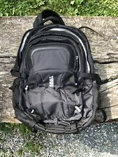 Thule EnRoute Escort laptop backpack with compression straps.