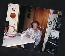 Old Vintage Photograph African American Woman Sitting At Table in Retro Kitchen
