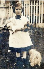 1910 Young Girl Holding Doll Pomeranian Dog CYKO Real Photo Postcard AN