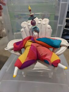 Poupee Millet doll And Chair. Colorful dress, headpiece. Signed, white chair