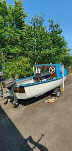 14 foot fishing boat with trailer, 3 outboard engines and loads of extras