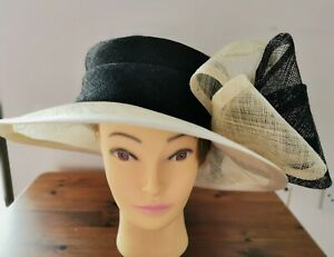 Libra black and cream straw hat with large bow decoration