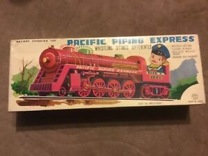 PACIFIC PIPING  EXPRESS TIN PLATE TRAIN + DRIVER MADE IN JAPAN RARE