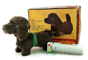 Battery operated walking dachshund toy with box & remote control Vtg 1960 German