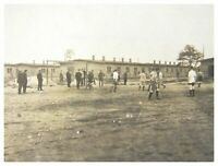 Antique military RPPC postcard German soldiers playing football POW Camp