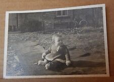 Photograph Social history Young Baby Sat on Rug In Garden Winter clothes 1950's