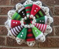 A HAND KNITTED XMAS ELVES WREATH. 12 INCHES DIAMETER...12 CHEEKY FACES LOL