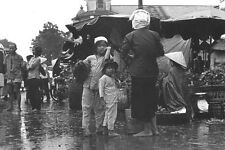 Vietnam 1971 -  Mother And Daughters At Cholon Market In The Rain