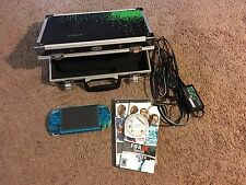PSP Slim 2000 Transparent Blue w/ 4GB Card, Charger, Case, and FIFA 08
