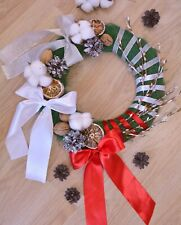 Christmas wreath, wreath on the front door, wreath with bows and cones