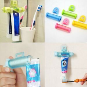 Bathroom Rolling Tube Toothpaste Squeezer Dispenser Tooth Paste Holder Plastic