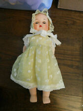 "Vtg Hard Plastic 13"" Brown Sleepy Eye Jointed Baby Doll Yellow Embroidered Dress"