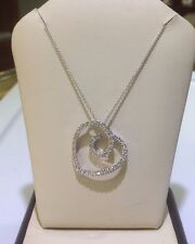 Heart shaped  pendant in  14k white gold with white  diamonds