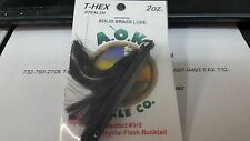 1 A.O.K. Lures T-Hex Solid Brass Lure Stealth w/Black Buck Tail 2 oz.