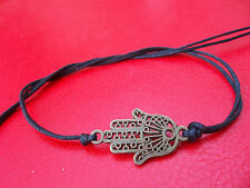 KARMASTRING black tie on bracelet with bronze hamsa for luck and protection baht