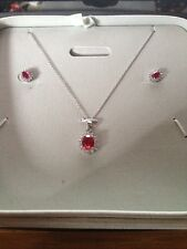 STAUER. ( RUBY ) DIAMONDAURA EARRINGS & NECKLACE. STERLING SILVER STAUER  BOXE