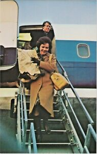 Rosalynn and Jimmy Carter departing Airplane for Inaugural on January 20, 1977