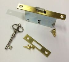 Baldwin Vertical/Upright Piano Lock Kit with Striker Plate, Key, & Screws, Brass