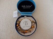 GOLD PLATED/AMBER COLOUR CHARM BRACELET BOXED, BRAND NEW AND NEVER BEEN WORN