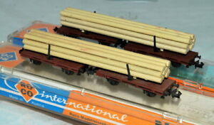 ROCO N  Brown  Strake Double Flat wagon with wood load in its box; Up to 2 Avail