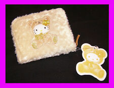 NWT Hello Kitty Wallet. Fuzzy, tan color with Hello Kitty. Free gift w/purchase!