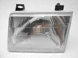 NOS New OEM Mercury Topaz Ford Tempo Left Halogen Head Lamp Light 1986-1987