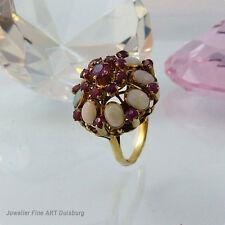 Ring in 750/Gelbgold mit 8 Opale + 18 Rubine ca. 2,2 ct.