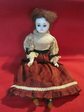 Antique mache head composition doll, glass eyes closed mouth