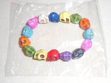 Neuf bracelet 15 perles têtes de mort multicolores