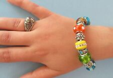 Silver tone add a bead bracelet with blue, green,yellow,orange & silver beading