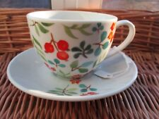 """Cup and saucer """"""""Red berries & leaf pattern """"""""( porcelain) CHRISTMAS SET."""