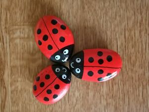 Hand Painted pebbles/stones set of 3 ladybirds