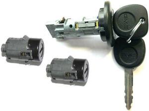 NEW GMC OEM IGNITION SWITCH LOCK CYLINDER + 2 DOOR LOCK CYLINDER + 2 KEYS