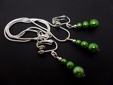 A PRETTY GREEN GLASS PEARL NECKLACE AND CLIP ON EARRING SET. NEW.