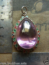 Beautiful Naga Eye stone set in a real Silver casing  , bright pink beautiful