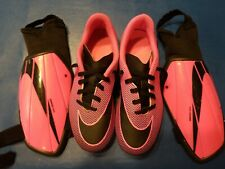 Nike 2y girls neon pink / black swoosh soccer cleats and medium shin guards.