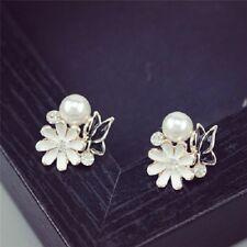 L'oro bianco margherita tono smalto e orecchini farfalla nera