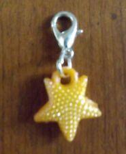charms argentée étoile orange 17x15 mm