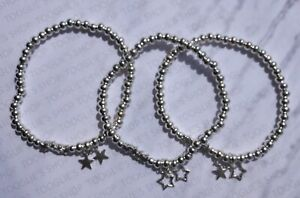 HANDMADE SILVER PLATED STACKING BEAD STRETCH BRACELET WITH STAR CHARM (008)