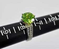 Gorgeous Ladies 18 Kt White Gold 5 Ct Green Peridot 0.6 Ct Diamond Ring